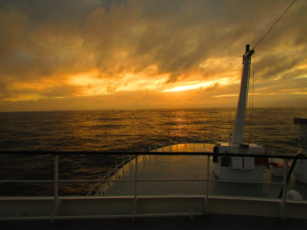 A sunset view from the bow of the ship