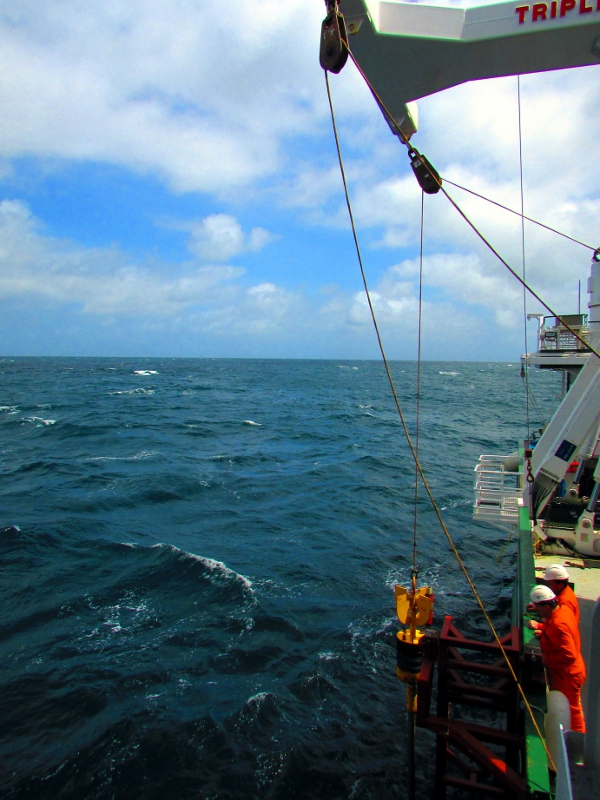Deploying a gravity core to take sediment samples through a coral carbonate mound