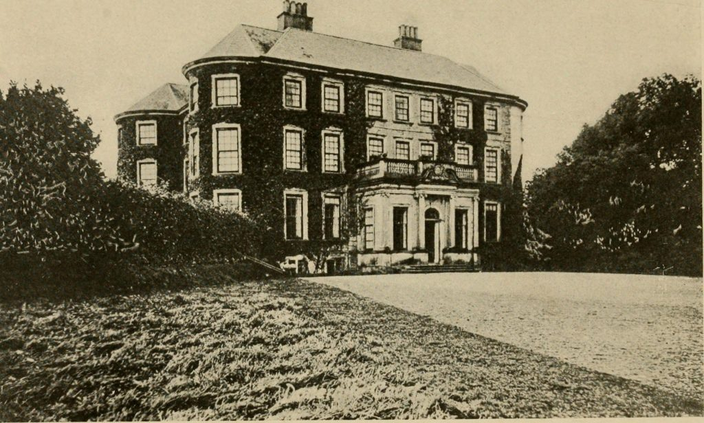 This image shows the outside of Doneraile Court house with ivy growing on the house.