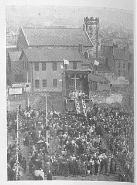"""A photograph from """"Franciscan Cork: A Souvenir of St. Francis Church, Cork """" of crowds attending Mass on the day of laying the foundation stone for the new St Francis Church."""