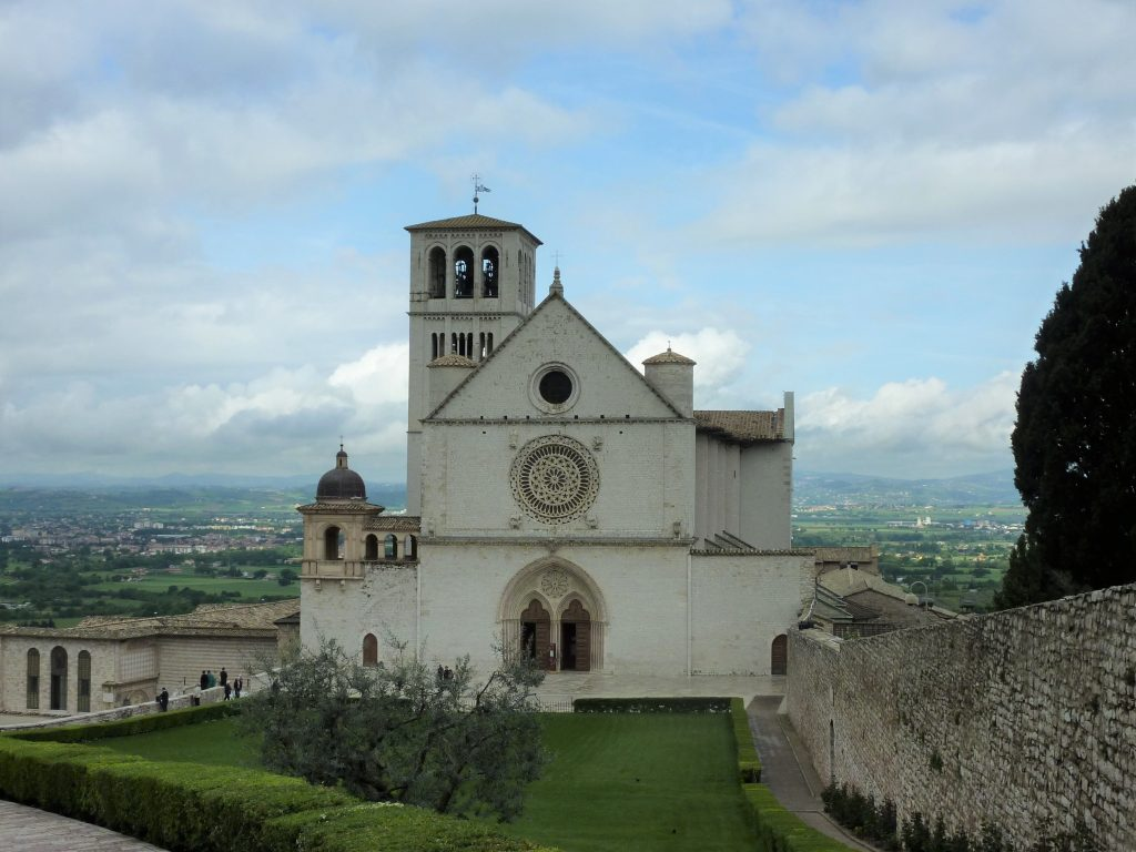 Photo of the Basilica of Saint Francis of Assisi in the Italian countryside.