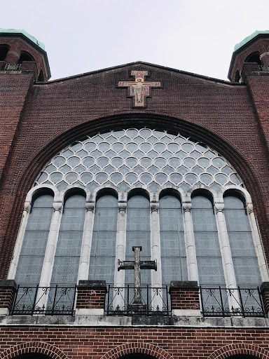 A photograph showing the facade of the St Francis Church in Cork with the San Damiano Cross in the centre.
